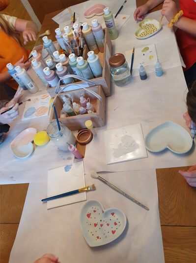 Paint ceramic bisques for children's birthday party with Fired Up Ceramics